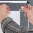 Pro-Display: постер крепится к рамке с помощью зажимов